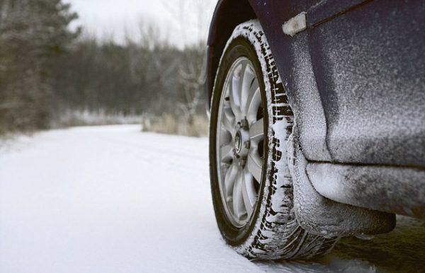 Car on Rural Road in Winter