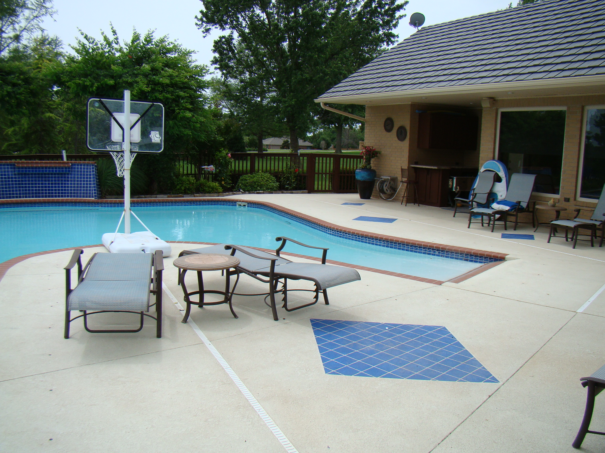 Spruce Up Your Pool Deck With Concrete Antiquing