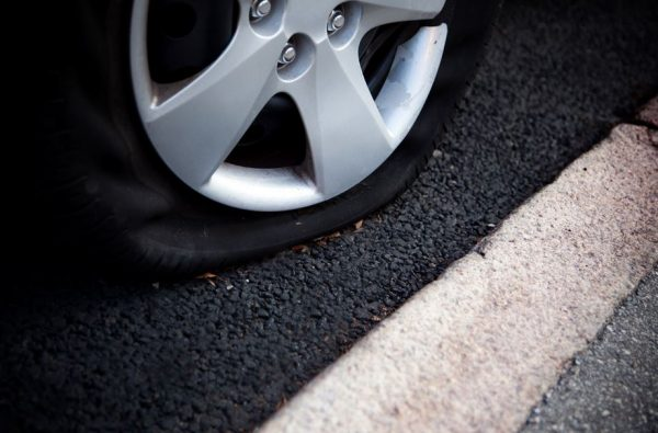 Don't Panic - 6 Steps To Fixing A Flat On The Highway